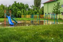 Submerged children playground after a storm Royalty Free Stock Image