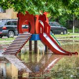 Submerged children playground after a storm Stock Photo
