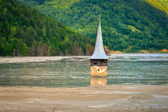 Submerged church in polluted lake at Geamana, Romania Stock Photo