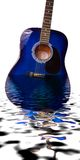 Submerged Guitar. Blue Acoustic Guitar which appears to be submerged in water with waves Royalty Free Stock Photography