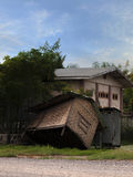 SUBMERGED HUT. HUT SUBMERGED IN MUD IN MANDALAY, MYANMAR/BURMA royalty free stock image
