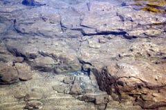 Submerged rocks Stock Images