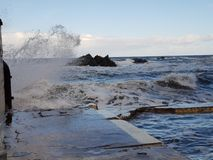 Submerged sea waves and Blue sky. In the ocean with Stone Beach stock image