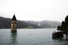 Submerged tower of reschensee church deep in Resias Lake Royalty Free Stock Photos