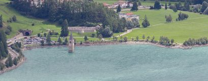 Submerged tower of reschensee church deep in Resias Lake in Tren Royalty Free Stock Photos