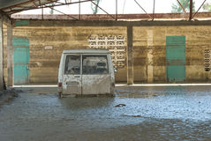 Submerged Vehicle. September 29, 2008 - A vehicle in a church compound in Gonaives, Haiti, is submerged in mud after Hurricane Ike dumped hundreds of tons of mud Royalty Free Stock Photos
