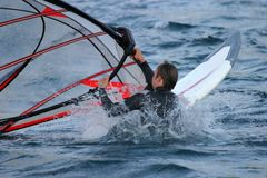 Almost submerged windsurfer. On rough sea Stock Photography