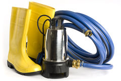 Submersible pump, rubber boots and water hose Royalty Free Stock Image