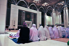 Submission. Muslim women in mosque praying stock photo