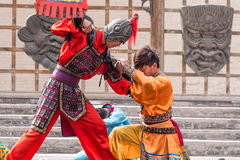 Submission. Two Chinese actors during a reenactment of a battle at the Jiayuguan fortress of the Great Wall of China royalty free stock photography