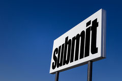 Submit. Big ad panel, embossed with the message Submit, isolated on blue sky royalty free stock photography