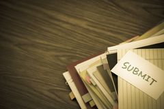 Submit; The Pile of Business Documents on the Desk.  Stock Images