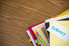 Submit; The Pile of Business Documents on the Desk Stock Photography