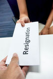 Submit a resignation letter. Close up submitting a resignation letter to the boss Stock Photo