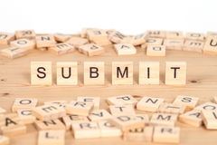 Submit,word written on wood cube Royalty Free Stock Photos