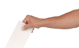 Submitting a Vote. A man's hand putting an envelope in a slot Royalty Free Stock Photos