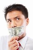 Subornez le concept, bouche scellée avec le billet d'un dollar Images libres de droits
