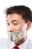 Subornez le concept, bouche scellée avec le billet d'un dollar Photos libres de droits