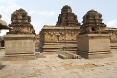 The Subrahmanya shrine on the left, the main sanctum in the centre and another shrine on the left side, Krishna Temple, Hampi, Kar. Nataka, India. Sacred Center stock images