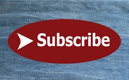 Subscribe word. `Subscribe` on blurred jeans background Royalty Free Stock Photo