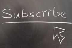 Subscribe. And mouse pointer drawn on chalkboard Royalty Free Stock Images