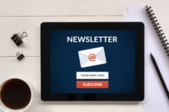Subscribe newsletter concept on tablet screen with office object Royalty Free Stock Image