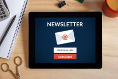 Subscribe newsletter concept on tablet screen with office object Royalty Free Stock Images