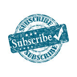 Subscribe rubber stamp. Blue grunge rubber stamp with the text subscribe written inside the stamp Royalty Free Stock Photography