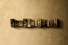 SUBSCRIPTION - close-up of grungy vintage typeset word on metal backdrop Stock Photography