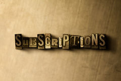 SUBSCRIPTIONS - close-up of grungy vintage typeset word on metal backdrop Royalty Free Stock Images