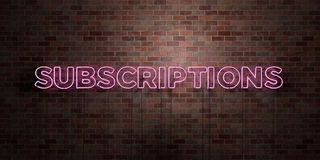 SUBSCRIPTIONS - fluorescent Neon tube Sign on brickwork - Front view - 3D rendered royalty free stock picture Royalty Free Stock Images