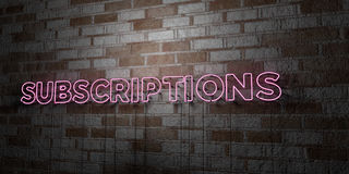 SUBSCRIPTIONS - Glowing Neon Sign on stonework wall - 3D rendered royalty free stock illustration Royalty Free Stock Photography