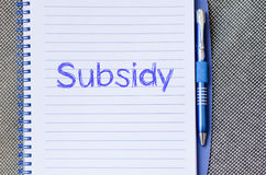 Subsidy write on notebook. Subsidy text concept write on notebook with pen Royalty Free Stock Image