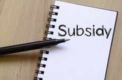 Subsidy write on notebook. Subsidy text concept write on notebook with pen Royalty Free Stock Photography