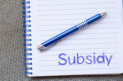 Subsidy write on notebook. Subsidy text concept write on notebook with pen Stock Image