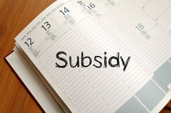 Subsidy write on notebook. Subsidy text concept write on notebook with pen Stock Images