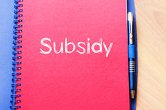 Subsidy write on notebook. Subsidy text concept write on notebook with pen Royalty Free Stock Photos
