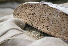 Subsistence farming. Loaf of bread and grain Stock Photo