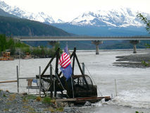 Subsistence salmon fishing in alaska. A water-wheel and bulldozers gathering at the copper river in the springtime Royalty Free Stock Photos