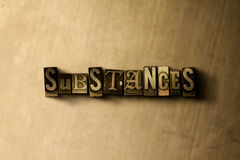 SUBSTANCES - close-up of grungy vintage typeset word on metal backdrop Stock Photography