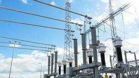 Substation converts electrical energy under sunlight. Closeup transformer substation converts electrical energy of one voltage into another under bright sunlight stock footage