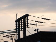 Substation at dusk. Electrical substation silhouetted against the sky at dusk Stock Photo