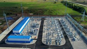 Substation for transmitting electrical energy in rural area. Aerial view small substation for transmitting electrical energy through wires near road in rural stock video