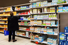 Substitute for dairy milk. MALMEDY, BELGIUM - MAY 2016: Aisle with various substitute for dairy milk product packings in a Carrefour Hypermarket Stock Photography