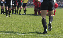 Substitution. Abstract image of a team game (rugby) moment- substitution Royalty Free Stock Photos