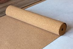 Substrate for a laminate. Natural cork substrate on the floor with laminate stock photo