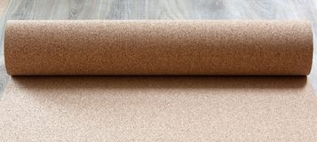 Substrate for a laminate. Natural roll with cork substrate for laminate royalty free stock photos