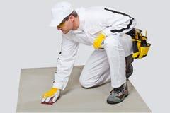 Substrato limpio del cemento del papel de la arena del trabajador Imagen de archivo