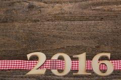 subtítulo 2016 en fondo de madera Imágenes de archivo libres de regalías