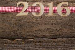 subtítulo 2016 no fundo de madeira Imagens de Stock